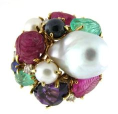 Vintage 18k yellow gold cocktail ring set with rubies, emeralds, sapphires, pearls and amethyst.