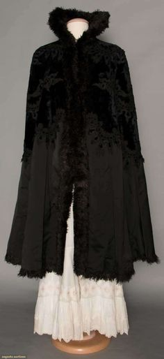 Black Velvet Evening Cape, 1890s, Velvet trimmed w/ black passementerie, high stand collar, black silk satin on lower half of cape, black maribou feather trim, black satin lining, L 43""