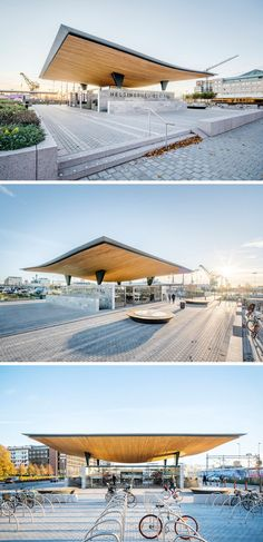 This Swedish train station has a sculptural timber roof positioned on two…