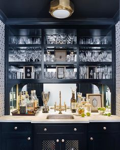 Any hour can be cocktail hour when the best bar in town is at home! Interior design by @courtneygilesinteriors featuring the Niles Flush Mount by Ralph Lauren Home in Natural Brass. #circalighting