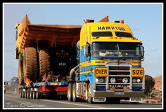 Hampton Transport Kenworth K104B hauls a Komatsu HD785 Dump Truck as it passes the Mt Pleasant Mine Site turnoff on the Goldfields Highway.
