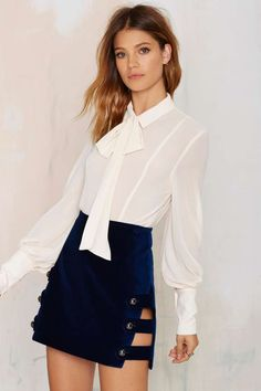 Killer with platform oxfords and a silk shirt, this blue velvet mini skirt is everything.