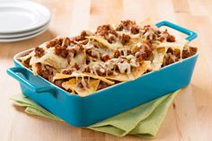 Create the tastiest Lasagna Nachos, Tostitos® own Lasagna Nachos Recipe with step-by-step instructions. Make the best Lasagna Nachos for any occasion. Nachos, Side Recipes, New Recipes, Favorite Recipes, Nacho Recipes, Tasty Lasagna, Tacos And Salsa, Best Appetizers, Cooking