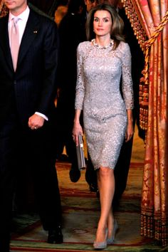 A short, long-sleeved frock is a welcome alternative to a long ball gown for evening.