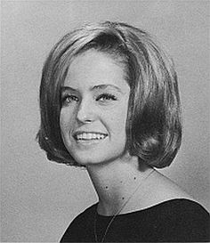 """This is the 1964 high school yearbook photo showing Farrah Fawcett when she was voted """"Most Beautiful"""" of her junior class at W.B. Ray High School in Corpus Christi, Texas. Fawcett, the """"Charlie's Angels"""" star whose feathered blond hair and dazzling smile made her one of the biggest sex symbols of the 1970s, died Thursday, June 25, 2009 after battling cancer. She was 62. (AP Photo)"""