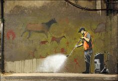"banksy cave art  The Lascaux cave drawings in France are the earliest skilled artwork known today. They depicted animals of the hunt and used relatively advanced paints for the time. By painting the wall and covering up ""graffiti,"" the man could be destroying something profound and respectable"