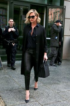 Charlize Theron was seen exiting her New York hotel looking like a city native in her all black ensemble.