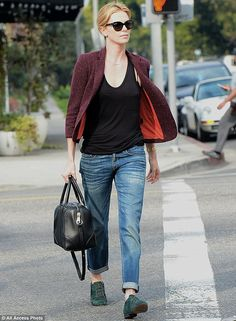 Stylish star: The mother-of-onestyled her outfit with green suede shoes, black leather handbag and oversized sunglasses