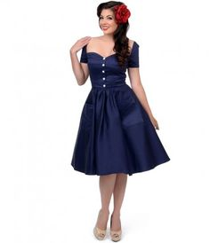We're in raptures! Presenting an enchanting lush navy swing dress that radiates vintage charm. Boasting a dainty button...Price - $50.00-xE8dbSud
