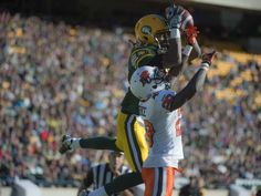 Reciever Derel Walker of the Edmonton Eskimos, hauls in the winning touchdown reception late in the fourth quarter despite coverage from of the Stephen Clarke of the BC Lions at Commonwealth Stadium in Edmonton. Shaughn Butts/Edmonton Journal