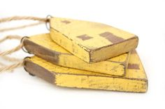 Little Yellow Houses, very easy to make & that ring through the hole at the top of the roofs not a bad idea too ;)