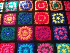 This Flower Garden Granny Square Afghan is made of five different square patterns including basic granny, cluster, popcorn flower, puff flower, and petal flower.