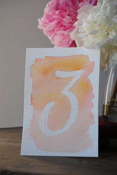 DIY Watercolor Table Numbers. Cute and simple if could figure out how to keep on the table