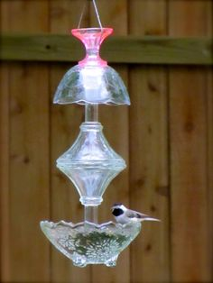 DIY Glass Bird Feeders! So pretty and easy!! She tells how she did it. Not in depth, but enough to figure out! xo