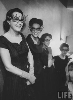 1960. Life Mag. Fancy eyeglasses and the little black dress.