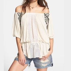 Free People New World Jersey Butterfly Tunic NWOT size Medium. A bohemian tunic designed to showcase your shoulders in a breathable jersey tunic. Drawstring waist. Beaded tassels that sway from him (at hips). Three quarter sleeves. Embroidered panels at front and back. Excellent condition. No flaws. Free People Tops