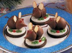Christmas Eve Mice... Oreos, Cherries with stems dipped in chocolate, Hershey Kisses, slivered almonds