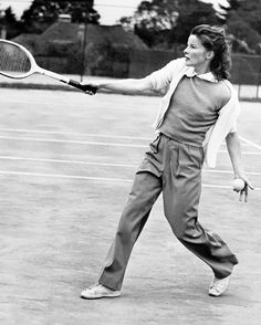 Kittypackards:Nattily attired in slacks, Katharine Hepburn, screen and stage star, returns a drive during a friendly game of tennis at the...