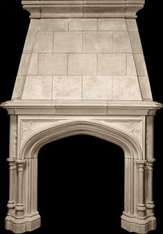 Sunbury Mantel and Decorated Overmantel from Tartaruga Design Inc. -- cast stone -- A deeply profiled Gothic arch dominates this mantel with English Gothic tracery embellishing the spandrels and side jambs.