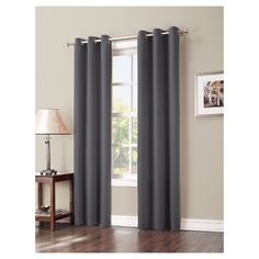 A Sun Zero, Greenwich Blackout Curtain Panel drapes beautifully and blocks light effectively in a perfect combination of pretty and practical. This stylish window panel boasts rich, solid coloring with large metal grommets for quick and easy installation. Room Darkening curtains are a must-have for late sleepers and make the perfect finishing touch to your room's revamped look. Whether you want to darken a room, block drafty windows, ensure privacy or simply add a touch of decoration to y...