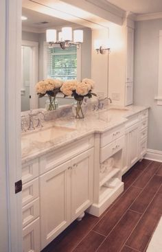 Classic Bath a way to hide the overhead lights in the built-in... large mirror, crown molding, lighting on top of the mirror
