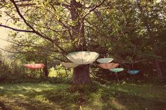 Image by @Heather Espana McGeehon  #wedding #oregon #tree #umbrellas #parasols #vintage #pink #blue #pastel