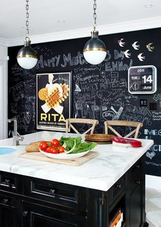 Love the chalkboard wall in kitchen