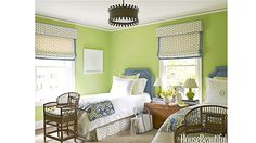 """Cheerful Green - HouseBeautiful  Designer Lindsay Coral Harper gave a more youthful and upbeat appearance to a dated 1940s suburban house in Charlotte, North Carolina. She painted the guest room a vibrant color, Benjamin Moore's Stem Green. """"It immediately made this simple little space so happy,"""" she says."""