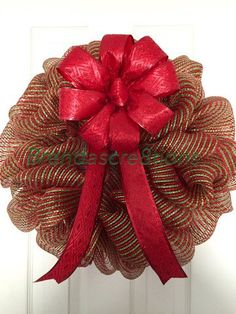 A personal favorite from my Etsy shop https://www.etsy.com/listing/254707109/red-and-green-christmas-deco-mesh-wreath