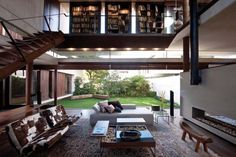 Couch over oriental rug... || Twin Houses Reflecting Contemporary Architecture and Interior Design