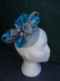 Hand made lily hat with sequins. Ma'dore Nz