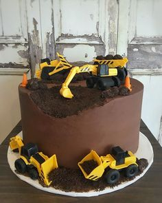 Chocolate and construction - what a perfect pair! This cake featured our chocolate cake, filled with white chocolate mousse and frosted in… Cake Truffles, Cupcakes, Cupcake Cakes, Truck Birthday Cakes, 3rd Birthday Cakes, Happy Birthday, Digger Birthday Cake, Birthday Kids, Construction Birthday Parties