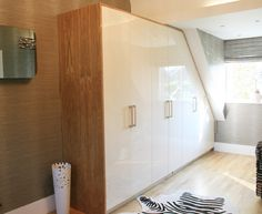 Bespoke Bedroom Wardrobes. Oak veneer and high gloss cream. Available in any colour.