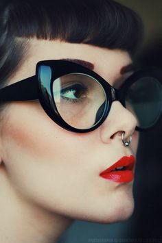 Glasses and piercing