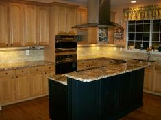 Oak kitchen cabinets, black island.