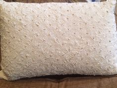 Pearl and sequins beaded lumbar pillow.  We found 2 of these pillows at Marshall's and picked them up.  We can take them back if they don't wind up working.