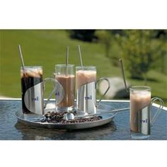 THE COFFEE SHOP 9 pieces: 4 hot and cool 8 oz glasses, 4 spoon/straws and aserving tray