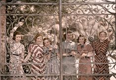 Students from five states smile through the gate of Ashley Hall in Charleston, South Carolina, March 1939.  National Geographic.