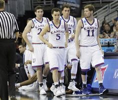 From left Kansas players Josh Pollard, Evan Manning (5) Christian Garrett and Tyler Self, (11) enter the game in the final minute of the Jayhawks 75-56 win over New Mexico State Friday, March 20, 2015 at the CenturyLink Center, Omaha, Neb. .