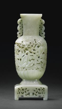 JP: A WELL-CARVED PALE CELADON JADE RETICULATED VASE, CHINA, QING DYNASTY, 18TH/19TH CENTURY