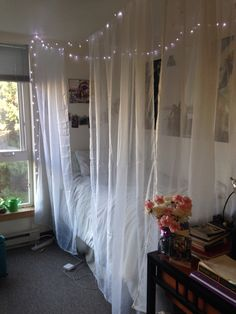 DIY dorm room canopy bed!  4 sheer curtains 3 Command ceiling hooks  String  Super cute and easy!