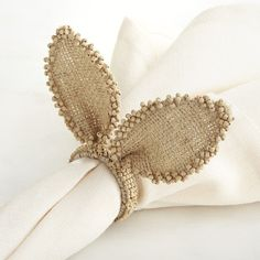 Pier 1 Imports Burlap Bunny Ears Napkin Ring ($3.95) ❤ liked on Polyvore featuring home, kitchen & dining, napkin rings, natural, burlap napkin rings, bunny napkin rings, pier 1 imports and rabbit napkin rings
