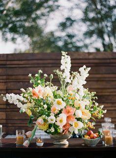 White and peach spring wedding flowers: http://www.stylemepretty.com/2016/09/20/modern-outdoor-ojai-wedding/ Photography: Michelle Beller - http://www.michellebeller.com/