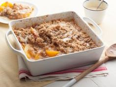 Peach Crisp with Maple Cream Sauce : Just a pinch of cinnamon adds fragrant warmth to the buttery brown sugar topping that coats juicy fresh peaches. Ree bakes the crisp until it's browned, then drizzles it with a maple syrup-laced sauce for added flavor in every bite.