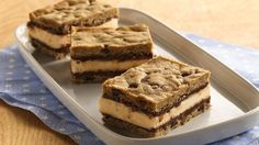 Cookies made from refrigerated dough team up with vanilla ice cream and fudge sauce for awesome homemade ice cream sandwiches.