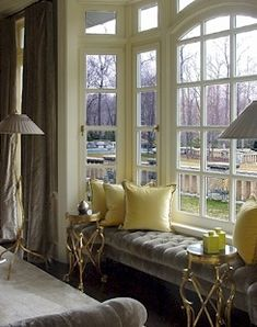 gold & gray room  Love the velvet gray tufted upholstered window seat in bay window with silk yellow silk pillows! Gray…