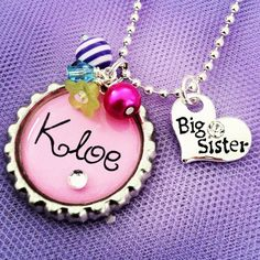 Personalized Girl's Charm Necklace Pink Big Sister Little Sister Bottle Cap Children's Jewelry Easter Basket Present Gift. $18.00, via Etsy.