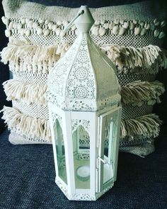 White bohemian style lantern from India, look at the flowers paterns.
