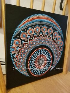 This original, handpainted mandala is done with acrylics on a cradled 12x12Birchwood Panel. This piece is an original design, painted by myself. It would make a great gift for someone special or for yourself. This piece would be a great addition to any room in the home or office. The