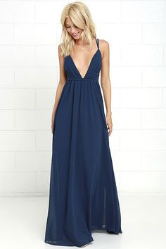 You'll soar right into our hearts with a look as splendid as the Flutter Freely Navy Blue Maxi Dress! Billowy bodice has a plunging neckline, supported by adjustable spaghetti straps and a second set of straps that cross at back and cinch the waist. Woven poly maxi skirt has a full, twirl-worthy silhouette. Hidden back zipper/clasp.